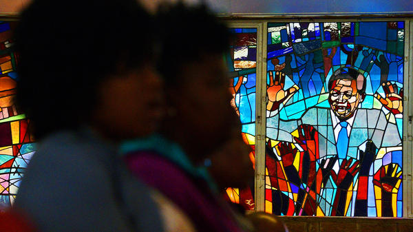 A stained glass window depicting former South African President Nelson Mandela at Regina Mundi church in Soweto, South Africa.