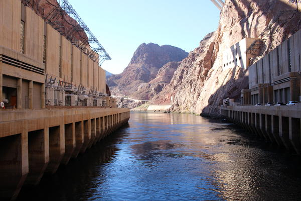 The Colorado River flows out of Hoover Dam at the Arizona-Nevada border.