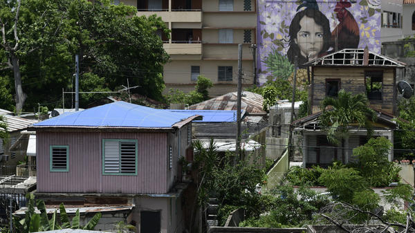 Some houses affected by Hurricane Maria remained covered in tarps or missing roofs as recently as June in San Juan, Puerto Rico's El Gandul neighborhood.