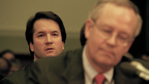 Brett Kavanaugh sits behind independent counsel Kenneth Starr as Starr testifies before the House Judiciary Committee on the possibility of President Bill Clinton's impeachment in 1998.