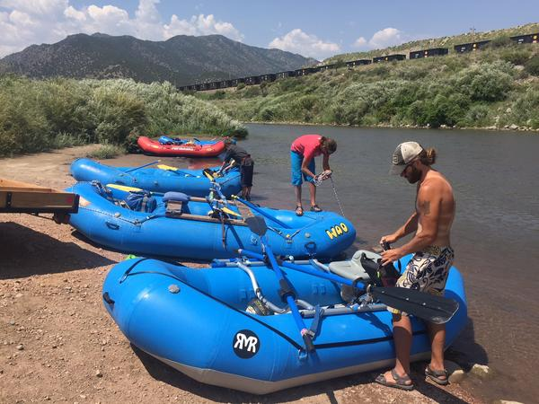 Jordan Poythress (foreground) prepares his raft to go down the Arkansas River
