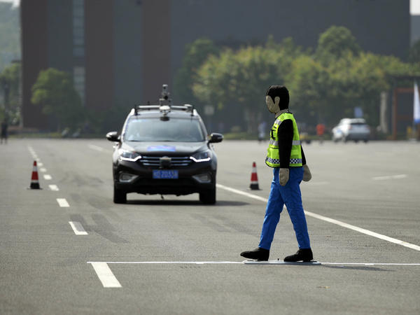 An unmanned automobile competes in the i-VISTA (Intelligent Vehicle Integrated Systems Test Area) Autonomous Driving Challenge on August 18 in Chongqing, China.