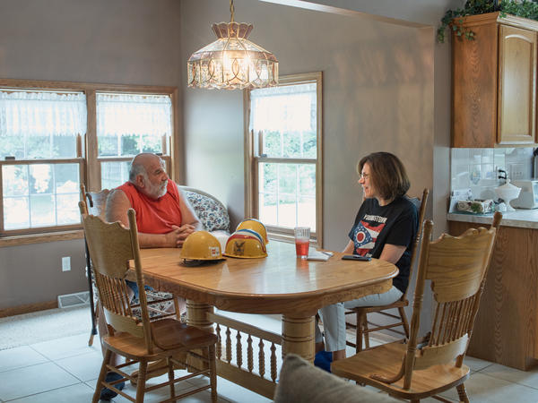 Pete Nicolaou and Marilyn Geewax talk at his home in July. Her visit showed how things changed dramatically for retirees in just one generation.
