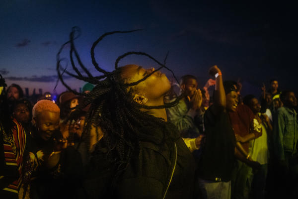 After hours of waiting, a festival attendee cuts loose in a mosh pit at the Afropunk Joburg festival in Johannesburg in December 2017.