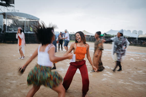 Rain can't dampen the spirits of Afropunk Joburg attendees. They continue to dance as rain begins to fall in Johannesburg in December 2017.