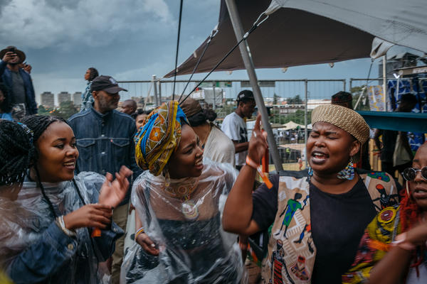 While the Afropunk Joburg festival was on pause because of the weather, crowds make their own music, singing freedom songs.