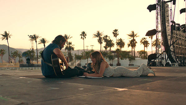 Jackson (Bradley Cooper) and Ally (Lady Gaga) jam in <em>A Star is Born</em>.