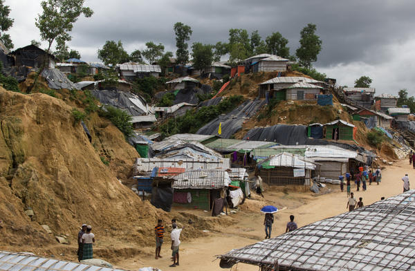 Tarps and refugee shelters cover steep hillsides in the Balukhali refugee camp in Bangladesh. Many of the sandy slopes have collapsed in the monsoon rains.