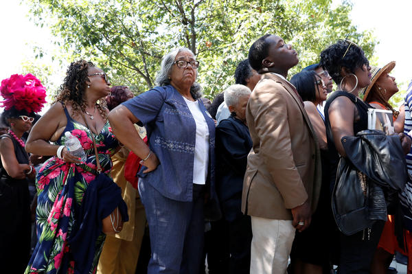 A line forms outside the Detroit church hosting the homegoing of Aretha Franklin, who died of cancer on Aug. 16.