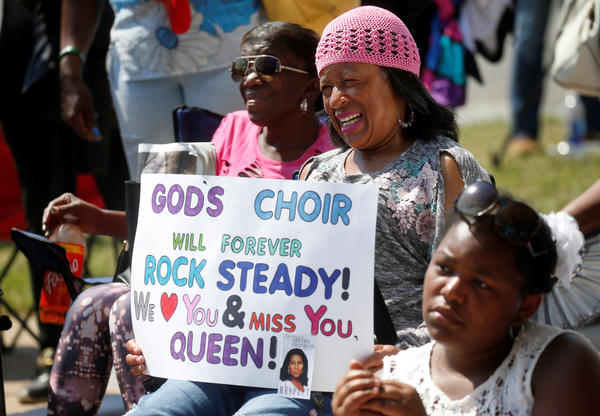 A woman holds a banner during the funeral service for Aretha Franklin at the Greater Grace Temple in Detroit, Michigan, U.S., August 31, 2018. REUTERS/Leah Millis - RC173F05A100