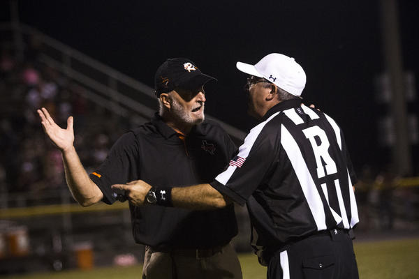 Jason Herring, head coach of the Refugio Bobcats, argues with a referee during a game in Ganado on Oct. 17, 2017.