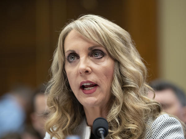 Kerry Perry, shown here testifying to lawmakers in May, has resigned from her post as USA Gymnastics President and CEO.
