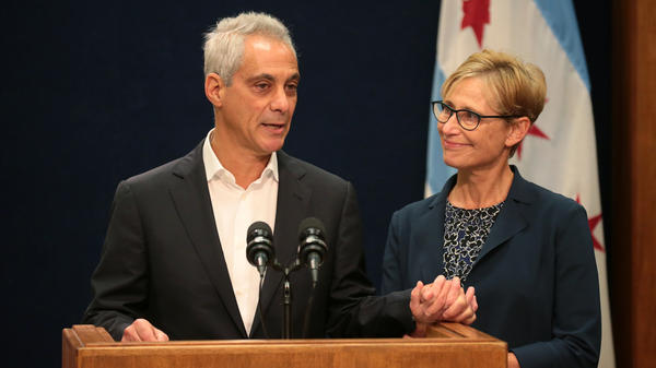 With wife Amy Rule by his side, Chicago Mayor Rahm Emanuel announces Tuesday at City Hall in Chicago that he will not seek a third term in office.
