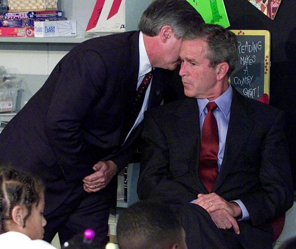 Chief of Staff Andy Card whispers into the ear of President George W. Bush to give him word of the planes that slammed into the World Trade Center in New York, on Sept. 11, 2001. Bush had received his daily intelligence briefing shortly before and had just begun a visit to the Emma E. Booker Elementary School in Sarasota, Fla.