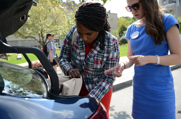 The car pulls over on Commonwealth Avenue a few minutes ahead of Pressley's next event — a TV interview with the Boston Neighborhood Network (BNN) — so that Pressley can pull together a new outfit.