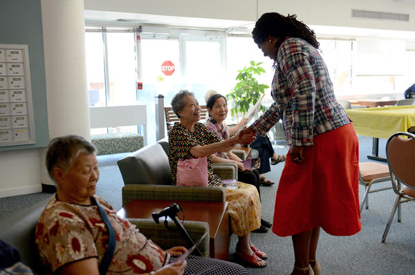 Pressley greets a small group of residents at Leventhal House, a senior living center in Brighton.