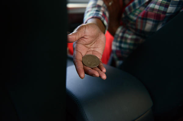 "In the car headed to her next event, Pressley pulls an old silver dollar out of her pocket. ""A gentleman just gave this to me and told me it brought him a lot of luck in his life and that he wanted to pass it on to me in the final stretch of our campaign,"" she said."