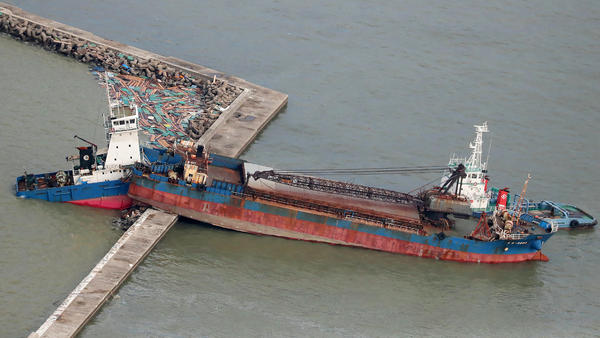 An aerial view from a Jiji Press helicopter shows a ship that collided with a breakwater due to strong winds caused by typhoon Jebi in Nishinomiya city, Hyogo prefecture on Wednesday.