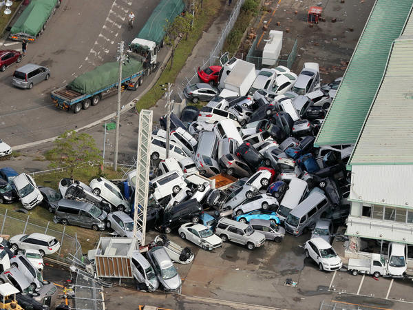 An aerial view from a Jiji Press helicopter shows vehicles piled in a heap due to strong winds in Kobe, Hyogo prefecture on Wednesday after typhoon Jebi hit the west coast of Japan.