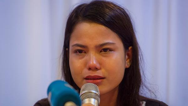 "Kyaw Soe Oo's wife, Chit Su Win, spoke Tuesday at a news conference in Yangon. ""I hope the state will have mercy on them,"" she said."