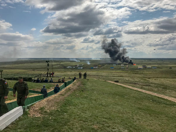 "Aircraft and ground troops from seven countries, including China and Russia, go through an ""anti-terrorist"" exercise at the Chebarkul tank range in Russia on Aug. 29."