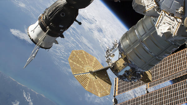A 2-millimeter hole was found last week in a Russian Soyuz MS-09 spacecraft (left) that is docked to the International Space Station.