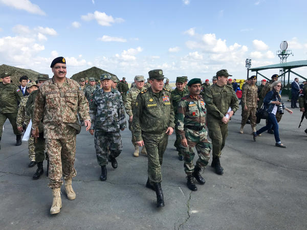 Valery Gerasimov, chief of Russia's General Staff (center), was joined by Gen. Zubair Hayat of Pakistan (left), Chinese Gen. Li Zuocheng (second left) and Indian Lt. Gen. Satish Dua (second right) at multinational exercises at the Chebarkul tank range in Russia on Aug. 29.