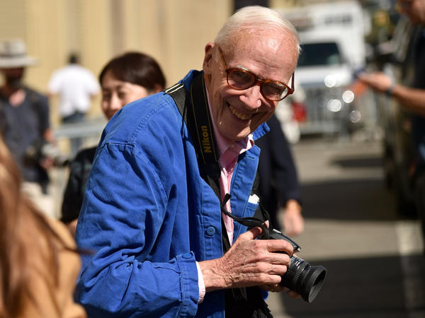 Bill Cunningham photographs guests leaving the Ralph Lauren Spring 2016 event during New York Fashion Week at Skylight Clarkson Square on Sept. 17, 2015 in New York City.