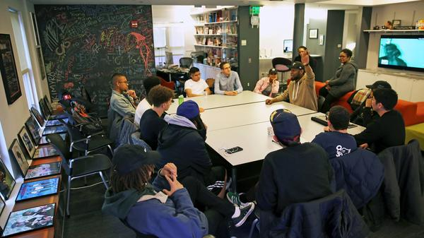 Producer 9th Wonder speaks with student staff members at The HipHop Archive & Research Institute in Jan. 2018.