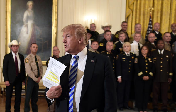 President Trump responds to a reporter's question during an event with sheriffs in the East Room of the White House on Wednesday.