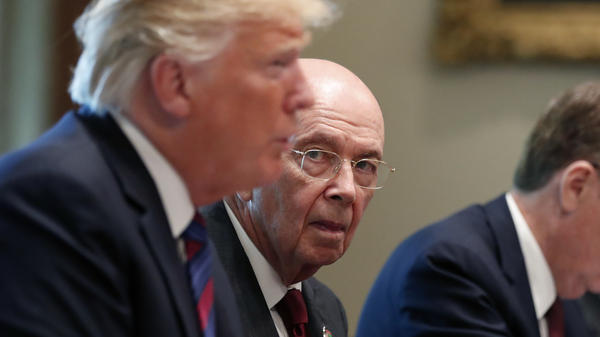 "Commerce Secretary Wilbur Ross (center) listens as President Trump speaks during a meeting at the White House in August. Ross, who oversees the census, approved adding a hotly contested question to the 2020 census that asks, ""Is this person a citizen of the United States?"""
