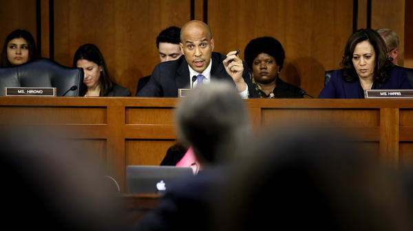 Sen. Cory Booker, D-N.J. — sitting next to Sen. Kamala Harris, D-Calif. — questions Supreme Court nominee Judge Brett Kavanaugh at the Senate Judiciary Committee hearing on Wednesday.