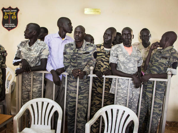 South Sudanese soldiers listened to the verdict being delivered at their trial on Thursday. A military judge found 10 soldiers guilty of rape and murder during a violent attack at the Terrain Hotel in Juba in 2016.