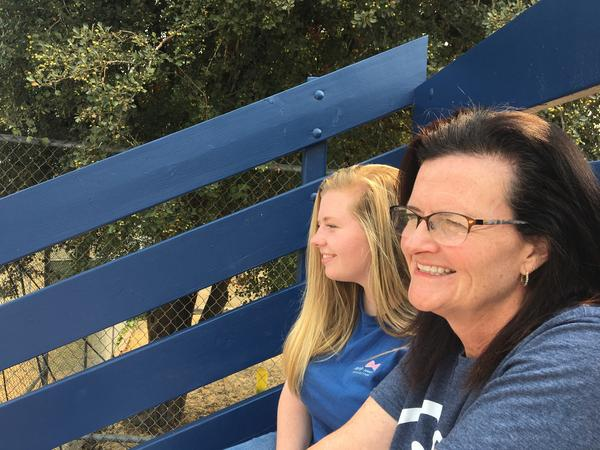 Sixteen-year-old McKenna Howard and her mother, Amy, at the Little League Softball World Series in Portland, Ore. this August. McKenna sang the national anthem at the event.
