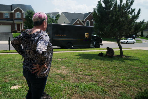 A UPS driver visits with Lizzy outside of Michel's home, something Michel says he does every time he drives through the neighborhood.