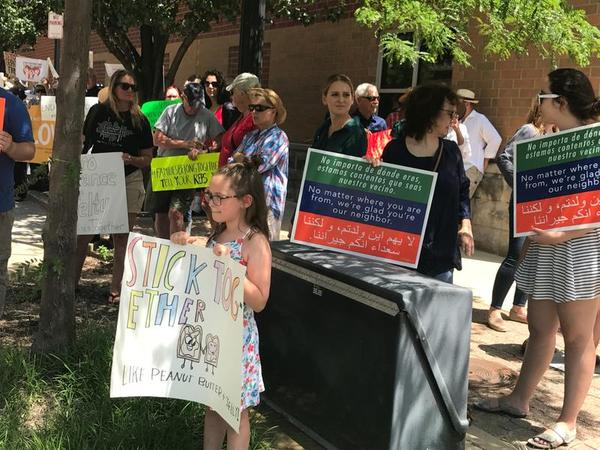 Rally in Springfield against an Immigration and Customs Enforcement policy that separates families at the U.S. / Mexico border.