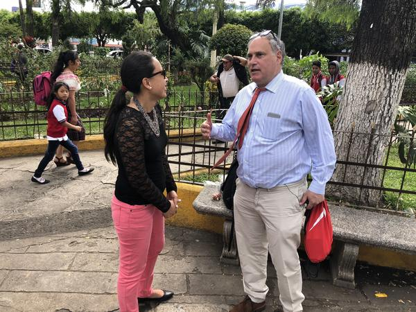 Lesly Tayes, a Guatemalan human rights lawyer and Lee Gelernt, lead ACLU lawyer, are part of an effort to reunite parents in Guatemala with their kids still being held in the U.S. They are standing in the central park in Chimaltenango, a town about two hours west of Guatemala City, Guatemala.