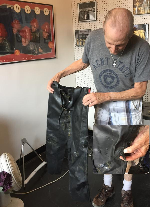 Wayne Beck shows off one of the museum's most unique pieces: a pair of pants made from innertubes for Rod Firestone of the Rubber City Rebels, complete with valve stems (inset).