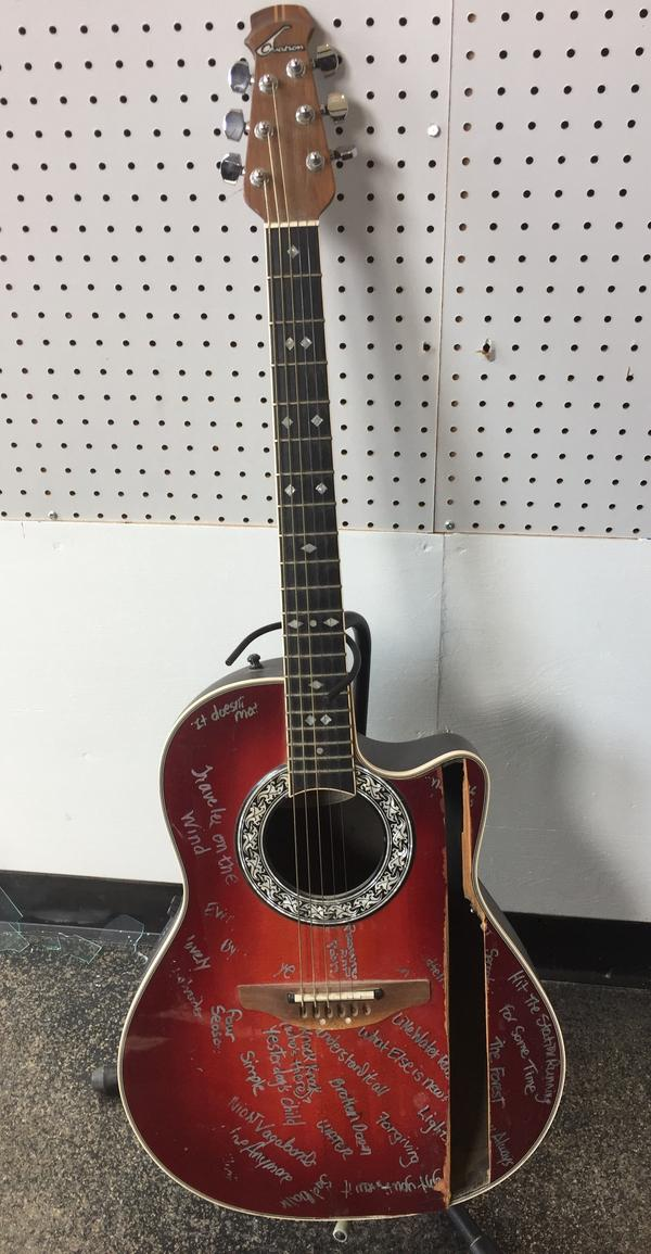 Sitting prominently in the Akron Sound Museum, this guitar is adorned with titles of completed songs by its owner, Unit 5's Tracy Thomas.