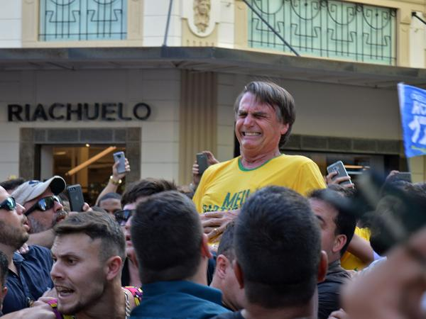 Brazilian right-wing presidential candidate Jair Bolsonaro gestures after being stabbed in the stomach during a campaign rally in Juiz de Fora, Minas Gerais state, in southern Brazil, on Thursday.