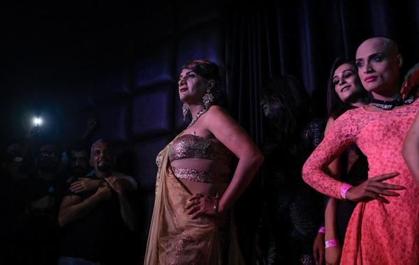 As celebrations in New Delhi continued into the early Friday morning hours, contestants in the upcoming Miss Trans Queen India 2018 competition pose in a gay club.