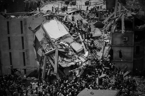 People rescue garment workers trapped under rubble at the Rana Plaza after it collapsed in Savar, outside the Bangladesh capital of Dhaka, on April 24, 2013. The collapse of the Rana Plaza factory complex is considered Bangladesh's deadliest industrial disaster.