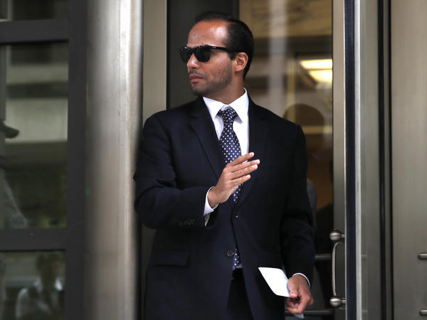 Former Trump campaign aide George Papadopoulos, whose actions triggered the Russia investigation, leaves federal court after he was sentenced to 14 days in prison on Friday. He had pleaded guilty to lying to the FBI.