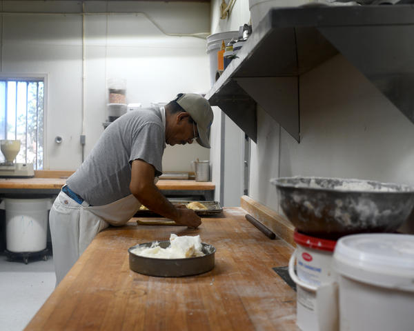 The Bowie Bakery is a well-known, traditional establishment in El Paso. Most of the older bakers working here, like this man, are residents of the U.S., but not citizens. The younger bakers are citizens, but not residents — they live across the border with their families in Juarez. Neither vote.