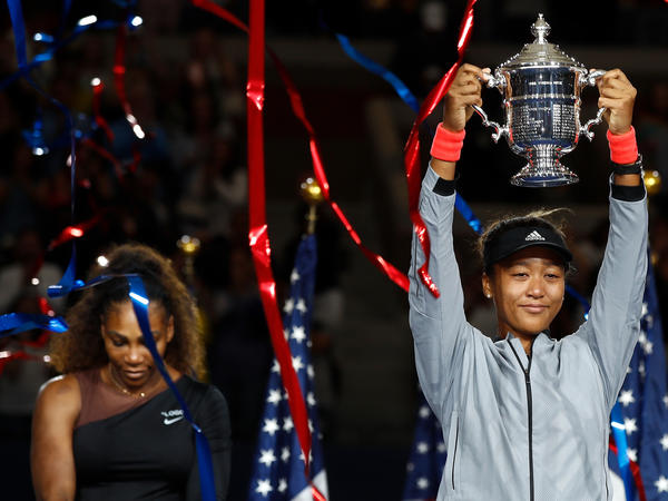 Naomi Osaka of Japan poses with the championship trophy after winning the Women's Singles finals match against Serena Williams at the 2018 U.S. Open.