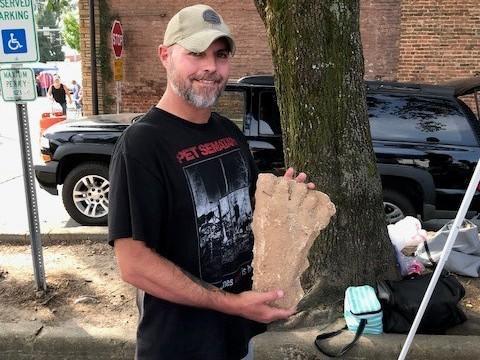 Bigfoot hobbyist Lee Woods displays a Bigfoot footprint cast.