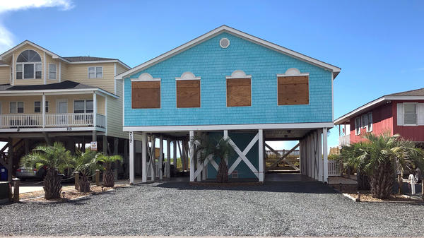 A boarded-up house in Holden Beach, N.C., can be seen ahead of Hurricane Florence's expected landfall.