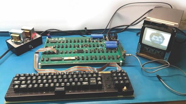 An Apple-1 circuit board is rigged up to a vintage keyboard and monitor. The board is one of only 200 manufactured in 1976.