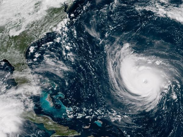 "Hurricane Florence, seen here in a satellite image from around noon Tuesday, could bring ""life-threatening, catastrophic flash flooding and significant river flooding."""