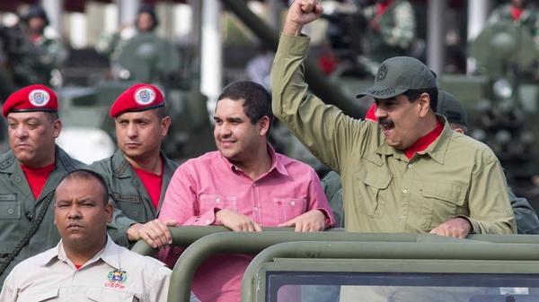 Venezuelan President Nicolas Maduro raises a fist during a military parade in Caracas this year.